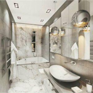 Łazienka z marmurkowymi płytkami i nowoczesnymi lampami